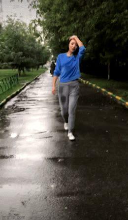 Hot asian with nice tits flashing in rain!!