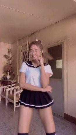Hot woman in miniskirt dancing