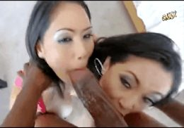 Two Asian whores worshipping a huge monster black cock