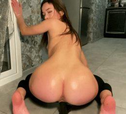 Sexy Asian rides black dildo